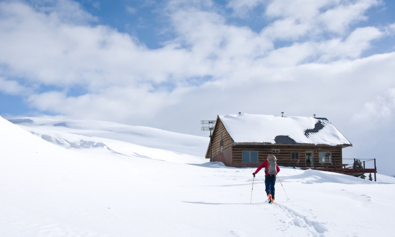 Backcountry Skier approaches Winter Hut