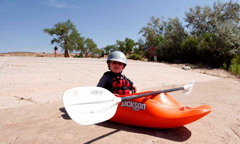 Kid Learning to Kayak